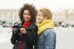 Happy girls with camera outdoors royalty free stock images