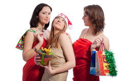 Happy girls on christmas. Three caucasian sensual girlfriends in christmas closing communicating together and holding gift box in front isolated over whote Stock Photo