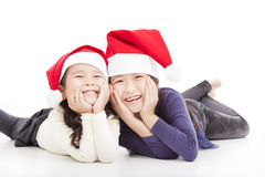 Happy girls in christmas hat. Isolated on white Stock Photo