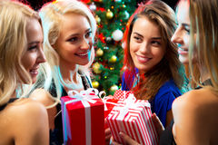 Happy girls at a Christmas party Stock Photos
