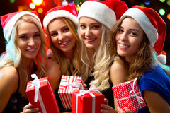 Happy girls at a Christmas party Stock Images