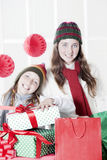 Happy girls with Christmas presents. Happy girls smiling with Christmas presents Royalty Free Stock Photo