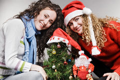 Happy girls with christmas tree. Happy two girls with christmas tree Royalty Free Stock Images