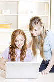 Happy girls with computer Stock Photos