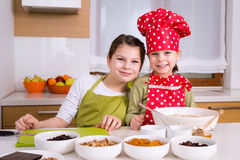 Happy girls cooking together Stock Images