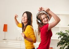 Happy Girls Dancing To Music Stock Photography