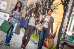 Happy girls doing shopping Stock Images