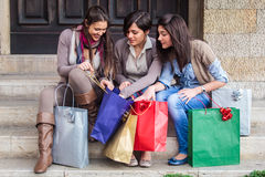 Happy girls doing shopping Royalty Free Stock Images