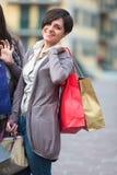 Happy girls doing shopping Stock Photo