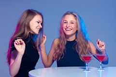 Happy girls with a drink in nightclub stock images