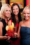 Happy girls drinking cocktails Stock Images
