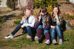 Happy girls eating an ice cream. Group of teenage girls eating an ice cream Royalty Free Stock Photography