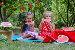 Happy Girls Eating Watermelons Stock Photos