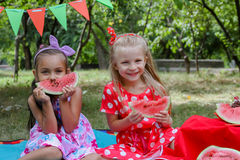 Happy Girls Eating Watermelons Royalty Free Stock Photography