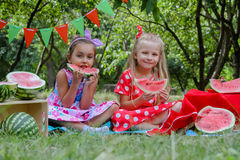 Happy girls eating watermelons Royalty Free Stock Images