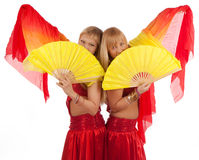 Happy girls with fantails. Two cute girls with fantails Royalty Free Stock Images