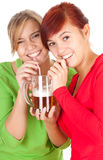 Happy girls friends with beer Royalty Free Stock Photos