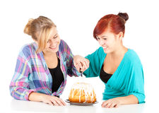 Happy girls friends with cake Stock Photo