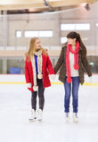 Happy girls friends on skating rink Royalty Free Stock Photography
