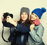Happy girls friends taking some pictures Royalty Free Stock Images