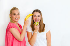 Happy girls with fruits Stock Photo