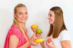 Happy girls with fruits Stock Images