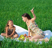 Happy girls on green grass Royalty Free Stock Photo