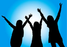 Happy girls with hands in the air. Group of happy young girls standing with hands in the air on blue sunny background Royalty Free Stock Images