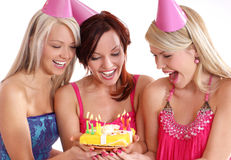 Happy girls having a Birthday party. Happy girls wearing pink party hats having a Birthday party with a cake. Image isolated on a white background stock photos