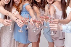 Happy girls having fun drinking with champagne on party. Concept of nightlife, bachelorette party, hen-party royalty free stock images
