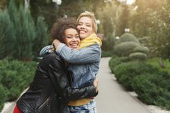 Happy girls having fun while walking in the park royalty free stock photo