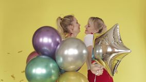 Happy girls having party and dancing on yellow background stock video footage