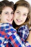 Happy girls hugging smiling in studio Stock Image