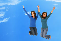 Happy Girls Jumping Over The Cloud Stock Photography