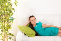 Happy girls laying on coach Royalty Free Stock Image