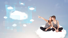Happy girls looking at modern cloud network Stock Image