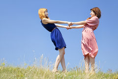 Happy girls at meadow. Royalty Free Stock Photo
