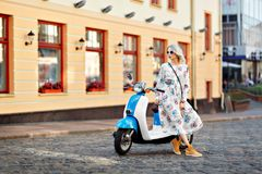 Happy girls on a moped. On street Royalty Free Stock Photography