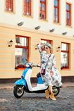 Happy girls on a moped. On street Stock Photography