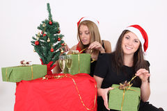 Happy girls open gifts in christmas Royalty Free Stock Photo