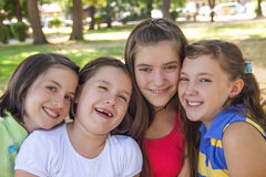 Happy girls in the park. Smileing happy cute girls laughing in the park Royalty Free Stock Photography