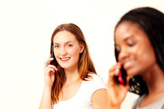 Happy girls on phone Stock Images