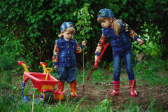 Happy girls planting tree Stock Image