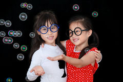 Happy girls play with soap bubbles Royalty Free Stock Photos