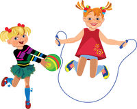 Happy girls playing with a ball and jump rope Stock Image