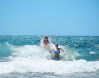Happy girls playing in beautiful ocean. Stock Photography