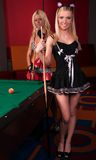 Happy girls playing in billiard Royalty Free Stock Photos