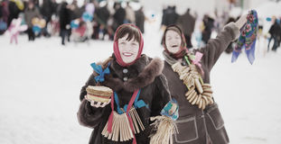 Happy girls plays during Shrovetide Stock Photo