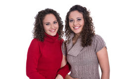 Happy girls: Portrait of real female twins wearing winter pullov Stock Images