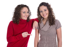 Happy girls: Portrait of real female twins wearing winter pullov Royalty Free Stock Photos